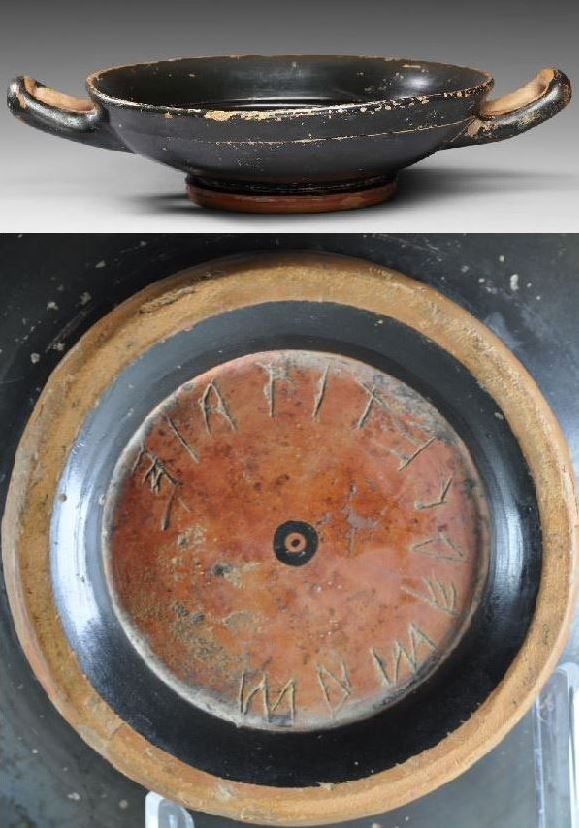 Greek kylix with Etruscan inscription, 4th-3d century B.C. Etruscan inscription on Greek kylix testimony of the dense commerce between Greece and the etruscan area, 17 cm long with handles. Private collection