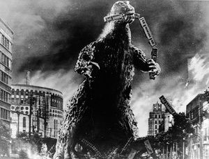 """Godzilla eats a commuter train - In 1954, an unstoppable force was unleashed on Japan, causing wide-spread destruction and panic.  It wasn't a typhoon, an earthquake, a tsunami, or aerial bombing, although it drew on all of those catastrophes for inspiration.  The 1954 disaster was a giant, fire-breathing monster called Godzilla.  (His name was originally Gojira, from gorira meaning """"gorilla"""" combined with kujira meaning """"whale."""") What Does Godzilla Mean to the People of Japan?"""