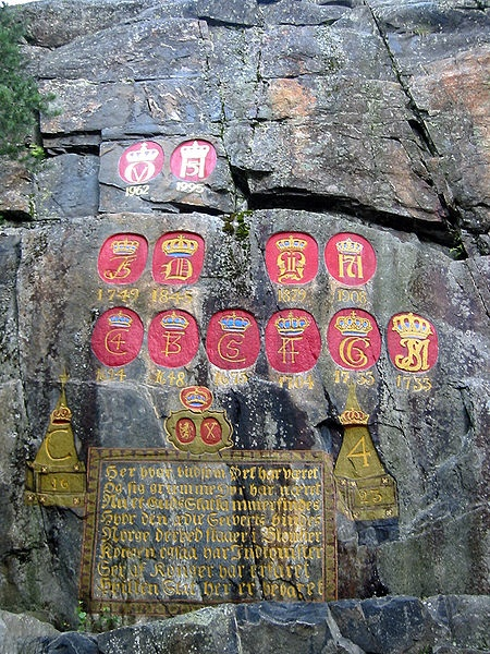 Norwegian royal monograms carved in a mountainside to mark royal visits to Kongsberg since 1623.