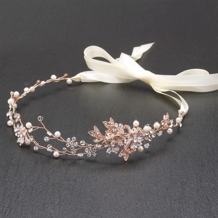 "Hand-painted metallic leaves, Swarovski crystal flowers and freshwater pearls are entwined with wire creating a breathtaking rose gold bridal headpiece. The flexible vine tiara headband has 14"" of del"