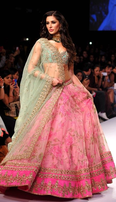 A gorgeous light teal and pink lehenga with hints of gold patterning.