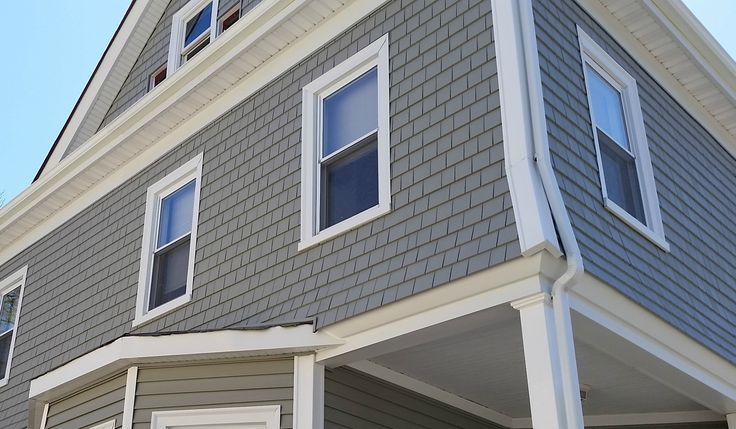 New Mastic vinyl siding & AZEK porch give this New Bedford, MA home a much needed facelift! See the transformation! Great before & after photos!
