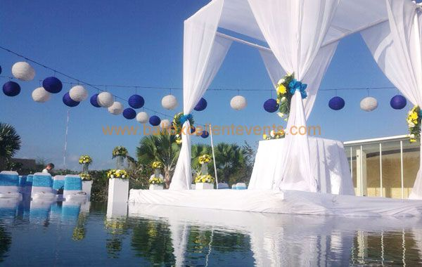 white wedding pergola floating over the pool