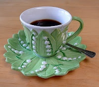 My lilly of the valley cup, the cup makes me think of Wendy, the coffee, Lori