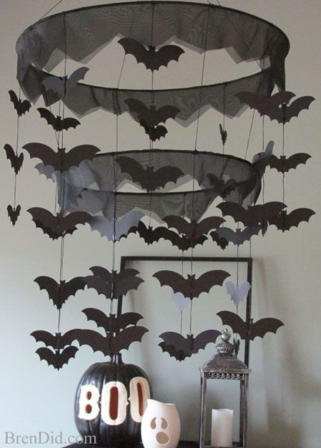 Pottery Barn Kids Inspired Bat Halloween Chandelier DIY with free Silhouette cutting file and PDF printable. A haunting addition to your Halloween decor.