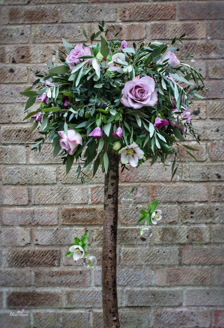 Looking for a tall table centre for your wedding? How about a floral tree? This one is filled with Memory Lane Roses, Clematis and Hellebores.
