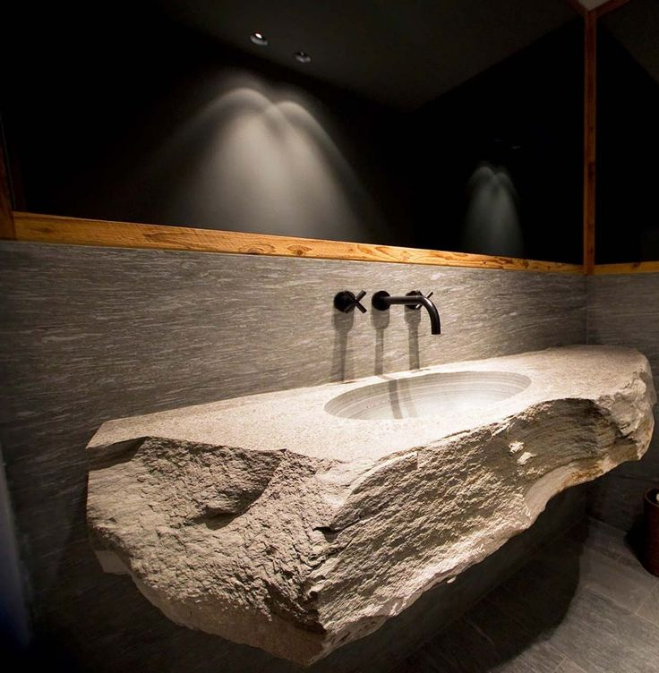 Charles Zana Architecte / chalet gstaad  Awesome huge stone sink and counter-top
