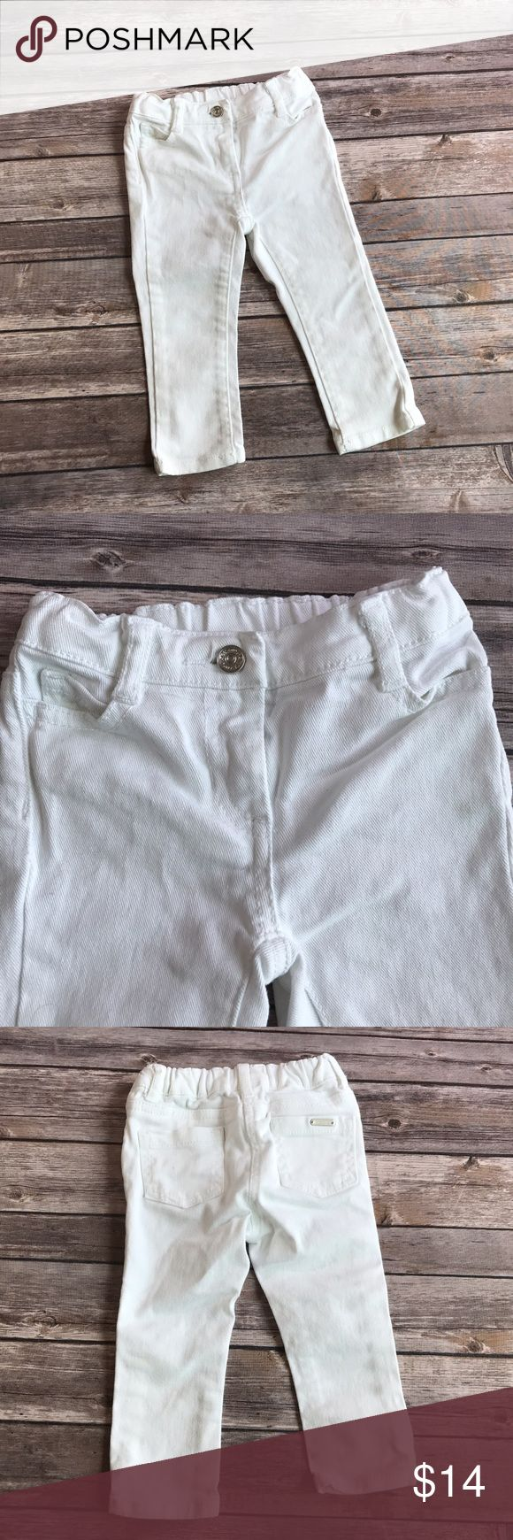 Janie And Jack White denim jeans White skinny jeans with adjustable waist band. One small spot on back pocket and on the back of one leg, shown in photos. Overall great condition and so cute! Janie and Jack Bottoms Jeans