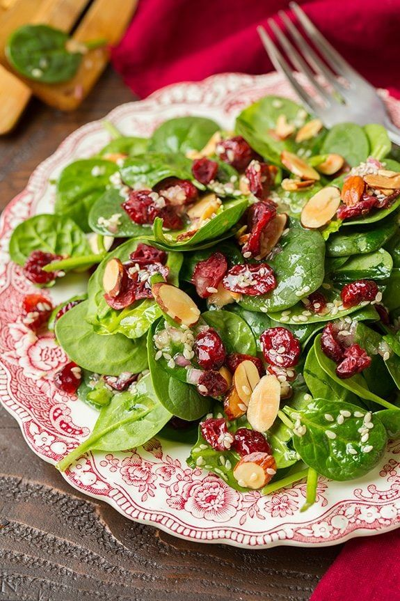 It's that time of year wheremost of us could probably use a few more greens in our diet between all those cookies :). Here is a simple Cranberry Spinach Salad with a Sesame Seed Dressing that would be perfect to serve on Christmas. It's got the perfect blend of sweet + savory + toasted crunchy goodness and you'll