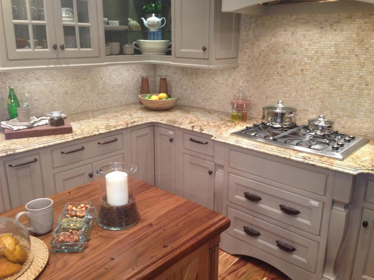 artisan stone collection granite countertops in golden crystal and heritage wood island in distressed black