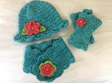 Miss Muffet beanie, buttonhole scarf and wrist warmers in teal brights.