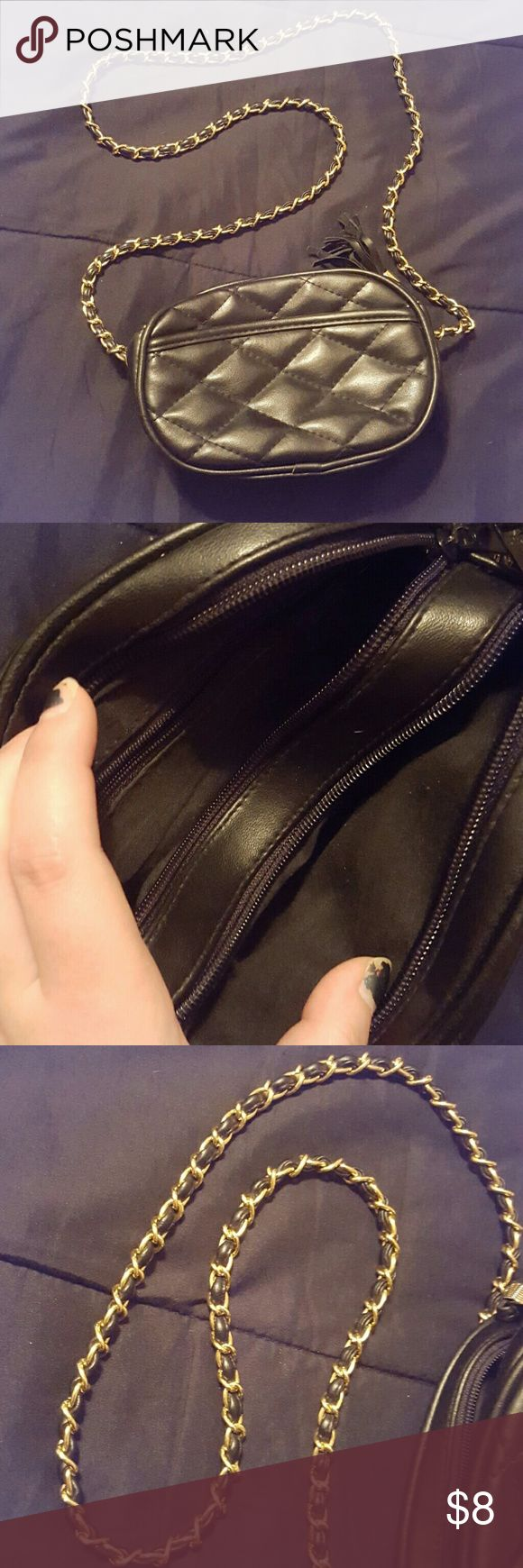 Black purse for sale! Small black purse for sale. Double pockets inside, zipper works great. Gold and black long strap. Small tassles on the zippers, one is missing ( see last picture ) Make me an offer! Bags