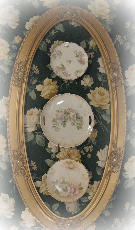 beautiful use of an old oval frame and especially pretty way to display family heirlooms