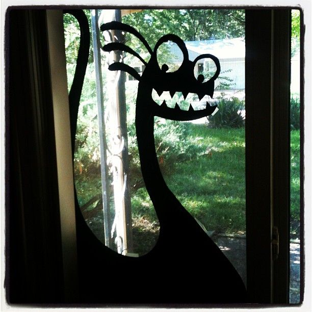 made shadow monsters for the window for halloween simply using a cardboard cut out and endless