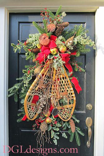 Atlanta Christmas door wreath using clients snowshoes cones berries fruit closeup photo