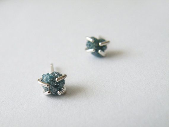 These studs feature two amazing green Diamonds, firmly held by handmade sterling silver prong settings. These African diamond are CONFLICT FREE and