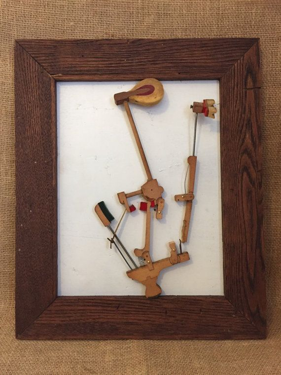 This unusual one of a kind wall hanging is repurposed from piano hammer mechanism and mounted in 12.5 x15.5 frame made of wood from a piano. Perfect