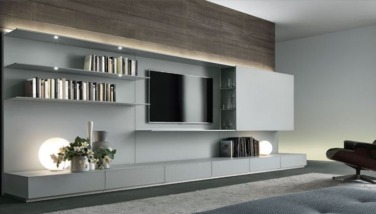 """Rimadesio's """"Abacus"""" shelves and wall units can be made with any combination of shelves and open space, with a variety of base-heights. The clean lines and crisp color options for the lacquered glass make this a contemporary answer to the entertainment system or bookshelf. View more options at haute-living.com/brands/rimadesio"""