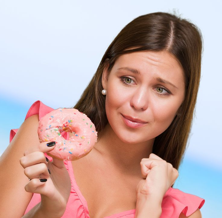 bigstock-Worried-Woman-Holding-Doughnut-41987197