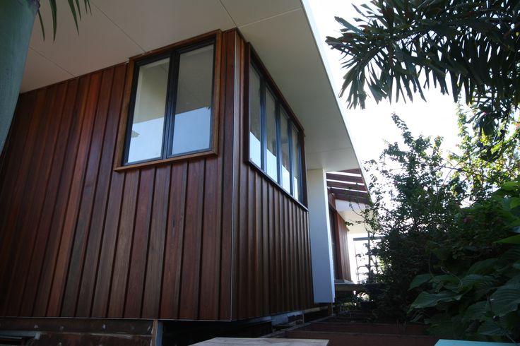 Feature Cladding, Cedar Shiplap, Black Aluminum Window.