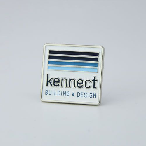 "Hard enamel pin with colored lettering. Note that ""Building & Design"" is silk screened on top of the enamel surface. This is how we accommodate colored text that is too small to hold color."