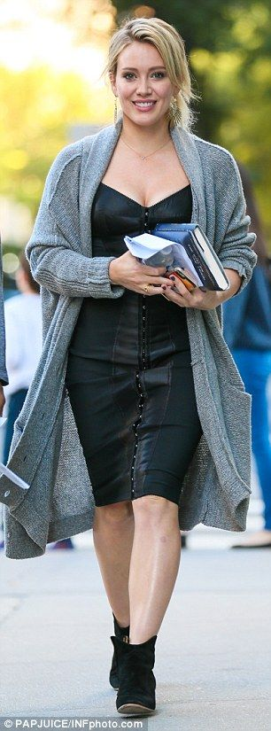 Hilary wears a cosy grey sweater on the set of Younger. Get more Hilary Duff style inspiration in the latest episodes of Younger on TV Land at http://www.tvland.com/shows/younger.
