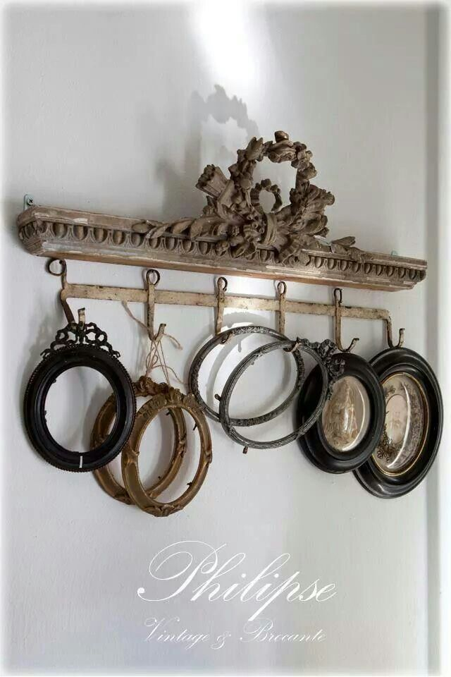 I believe this is an architectural piece with an added ornament, but I have done this using a beautiful antique frame that was broken and added the bottom hooks. It looks beautiful when finished.
