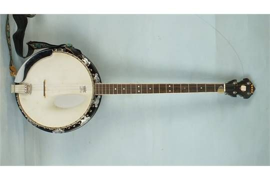 Lot 373 - A four-string banjo with 'Remo Weather King' banjo head, 95cm overall, cased and a quantity of banjo