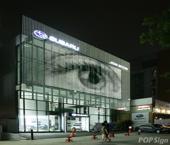 cool glass facade in South Korea. The part with the eye is actually a transparent LED glass video screen.  Made with powerglass® from Glas Platz