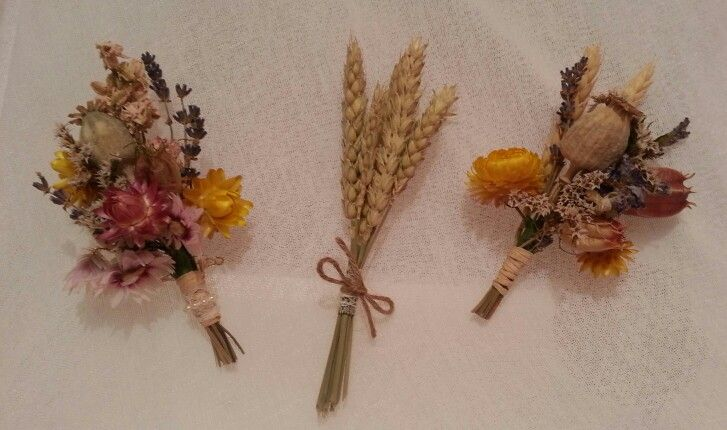 Buttonholes made with dried flowers.