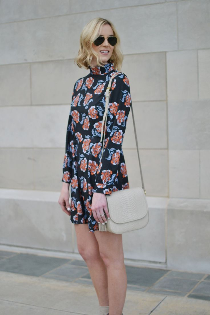 floral mini dress with high collar, cream boots and cream bag