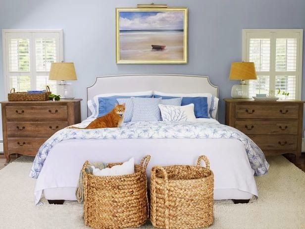 Everything Coastal....: A Collection of Beach Cottage Bedroom Inspiration  Love the baskets at the end of the bed.