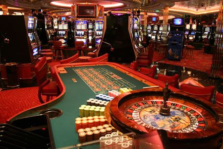 Roulette table and slot machines at casino