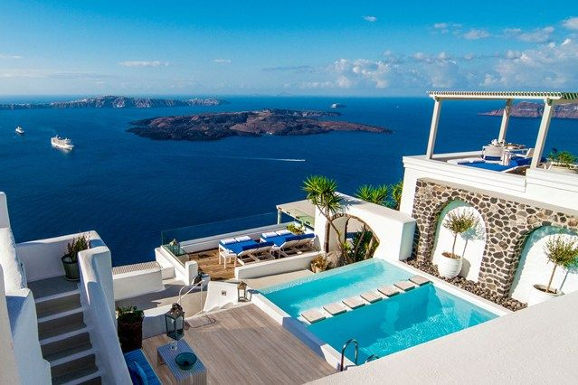 Iconic Santorini Hotel, Santorini, Greece - Overlooking the Greek island's famed sapphire waters, a hotel that lives up to its name. The hotel is carved over five levels into the caldera cliffs, offering an abundance of views.