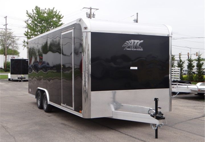 20' Black Enclosed Car Hauler By ATC. This Is an Outstanding Enclosed Car Hauler Which Features a Screwless Exterior, LED Exterior Lights, and a 7' Interior Height. $8,995 Any applicable fees and taxes are extra. Ref # HE205479   Advantage Trailers and Hitches