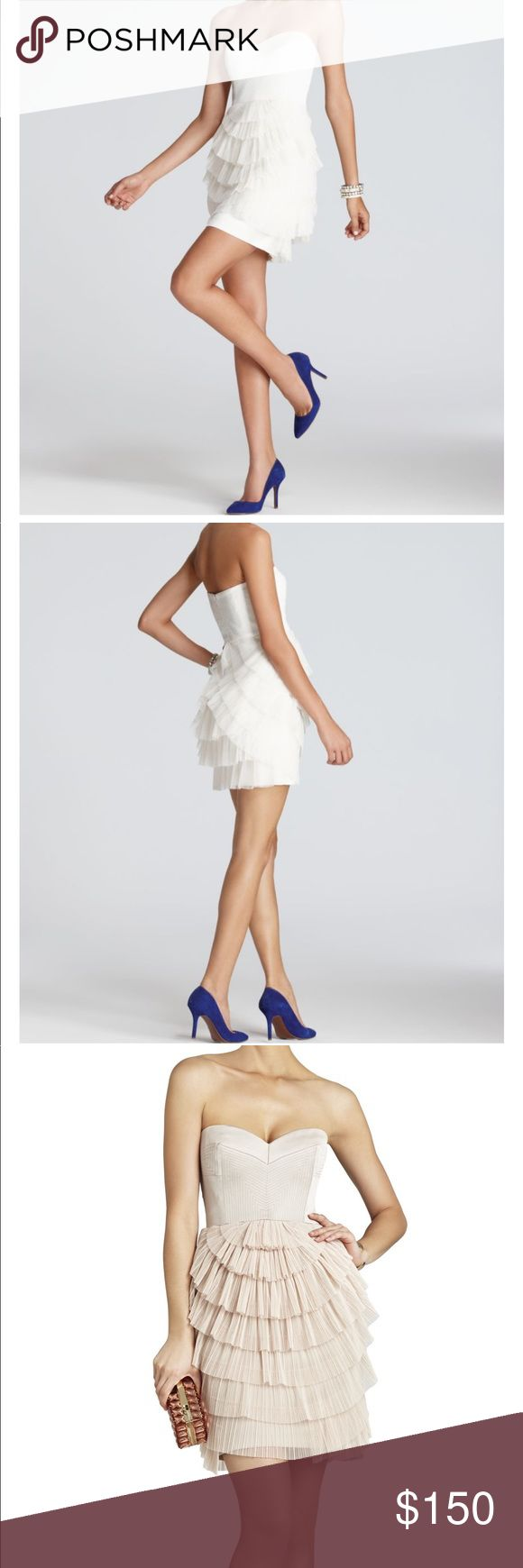 "BCBG  MAX AZRIA  Sas Strapless Pleated Dress The perfect party dress for any adventure, from happy hour to after hours. (Separate straps are included if support is needed) Measures approximately 25"" from neckline to hem. Classic fit. Sweetheart neckline. Strapless. Topstitched bodice. Contrast trim. Tiered, contrast-knit skirt with pleated detailing.  Concealed center back zipper with hook-and-eye closure. Self: Acetate, Nylon, Spandex satin. Contrast: Polyester mesh. Lining: Polyester crepe…"