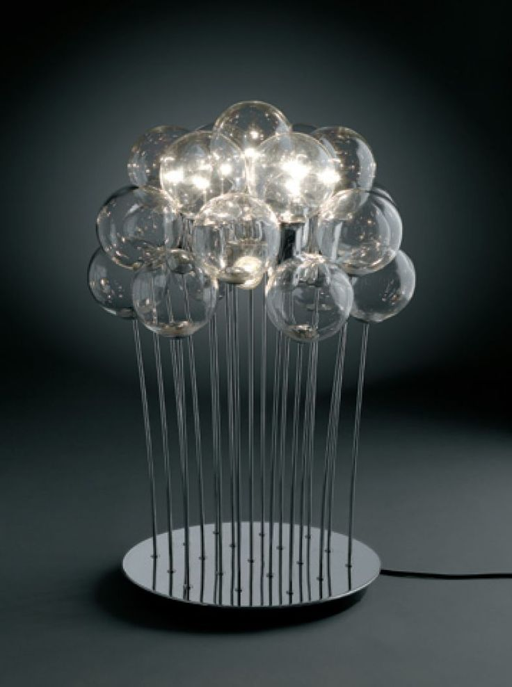 Table lamp with crystal blown spheres, and bulb socket covers in chromed metal frame. Round or square base. 7 long life globe bulbs, 3 standard bulbs and 12 spheres. Disegn by Marco Agnoli for SP LIGHT and DESIGN
