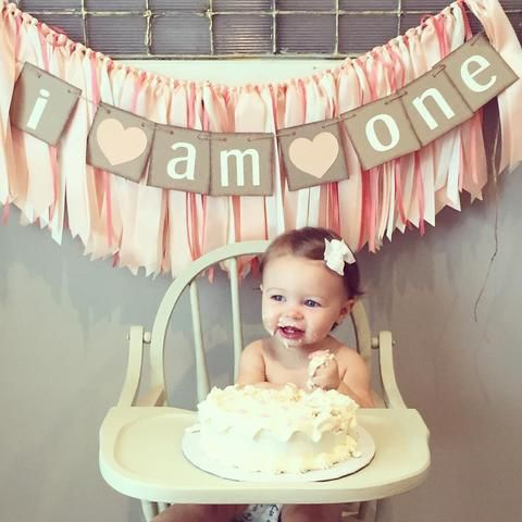 We enjoyed making this beautiful light peach, coral, and ivory fabric garland for Amanda and her precious 1st birthday girl! Thanks for sending in the photo!