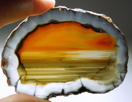 Agate Slice. Looks like a sunset over the ocean.
