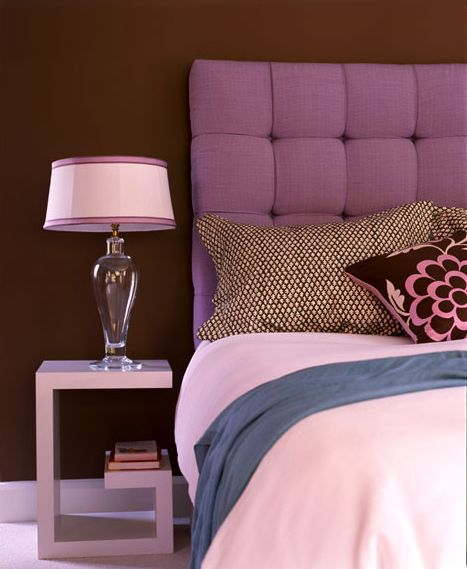 Amanda Nisbet takes the plunge into purple with a deeply tufted headboard set against a deep aubergine wall with hints of pink and chocolate brown.