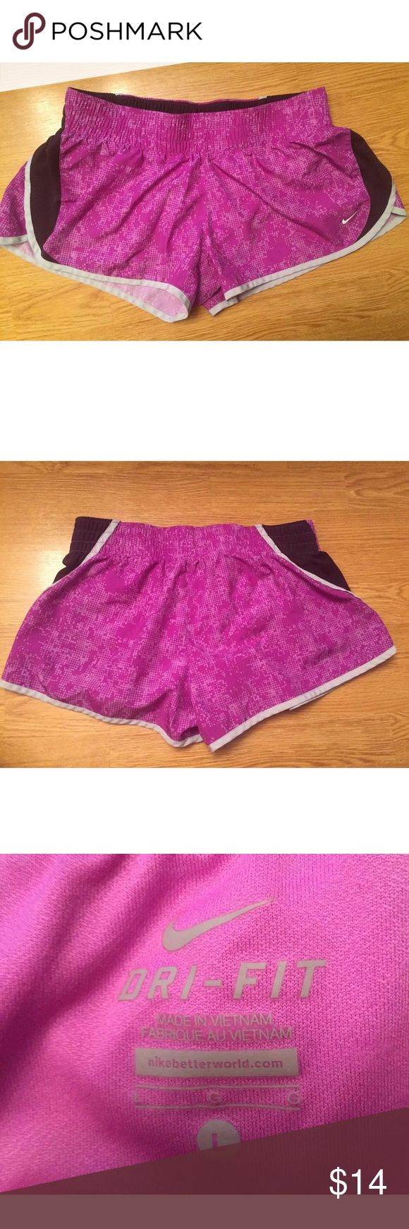 Nike Women's Dri Fit Pink & Purple Shorts Sz L Women's Nike Athletic Running Shorts •Size large •Pinkish Purple color •Dri Fit line from Nike •Stretchy waist band •Breathable material •Great condition - no flaws! •Length: 9.5 Inches & Waist: 15 Inches  Let me know if you have any questions and make me an offer! Nike Shorts