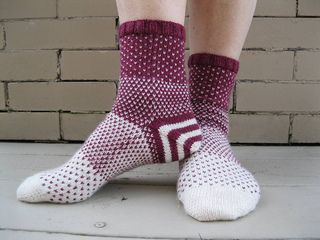 Disappearing Act socks by Michelle Hunter. Watch one color fade playfully into another in this toe up sock pattern that makes the most out of minimal yardage. Directions for a striped afterthought heel are just part of the fun in this two colored sock. Watch the  video for tips. The pattern is free on Ravelry!