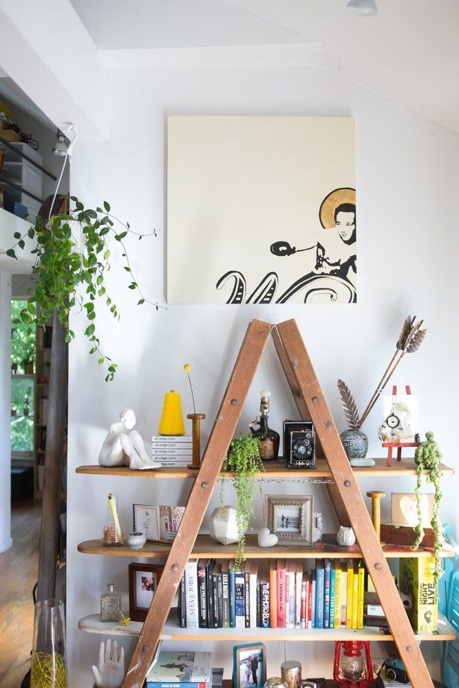 """Name: Marta Sasinowska and Mike Nourse Location: Pilsen neighborhood — Chicago, Ilinois Size: 1,500 square feet Years lived in: 5 years; Rented Marta and Mike like to call their apartment """"the tree house,"""" because of the lofted spaces, the hammock, and the light streaming in through different corners as if through the branches of trees. In fact, their home is surrounded by songbird-filled trees outside and is full of plants inside, adding to the magical feeling of living in the sky."""