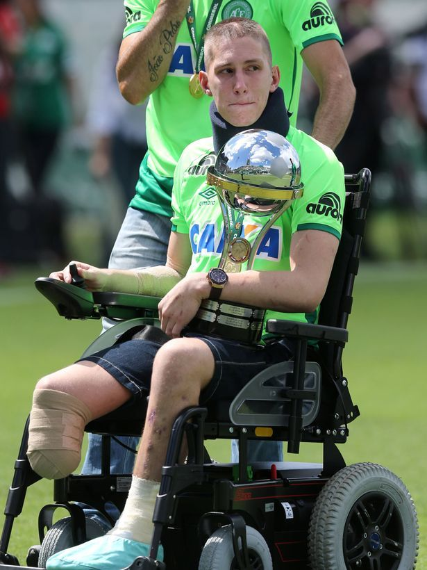 Goalkeeper Jackson Follmann, who survived when the plane carrying Brazilian soccer team Chapecoense crashed, carries the Copa Sudamericana trophy
