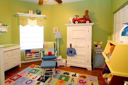 Love a bright, colorful nursery--maybe with a children's book theme?  Must have this alphabet rug!