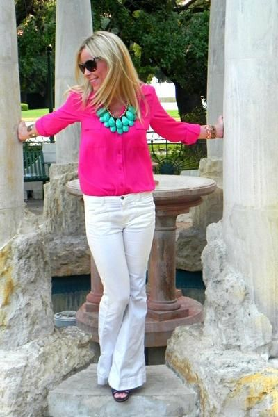 white pants, hot pink blouse and teal jewelry