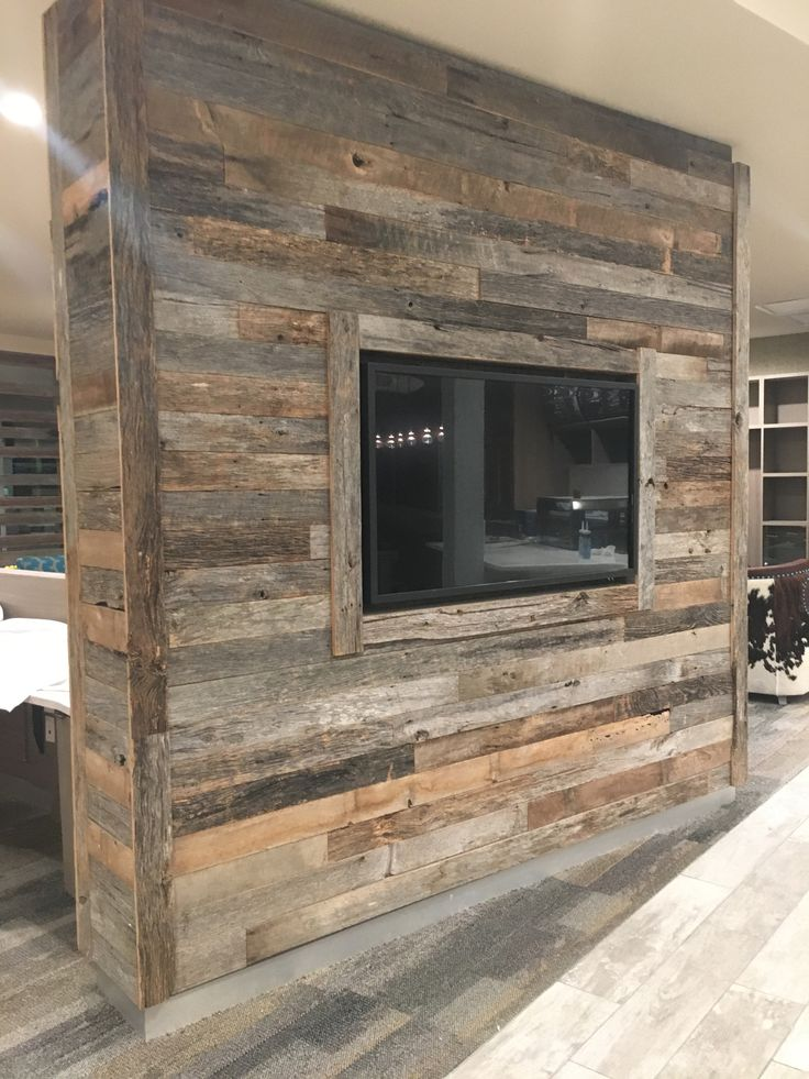 Faded gray barn siding feature wall in a mobile al