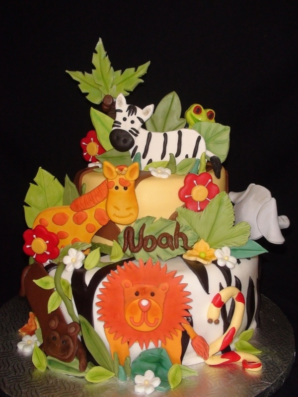 jungle animal birthday cake, so adorable....maybe make a little more girl colors!