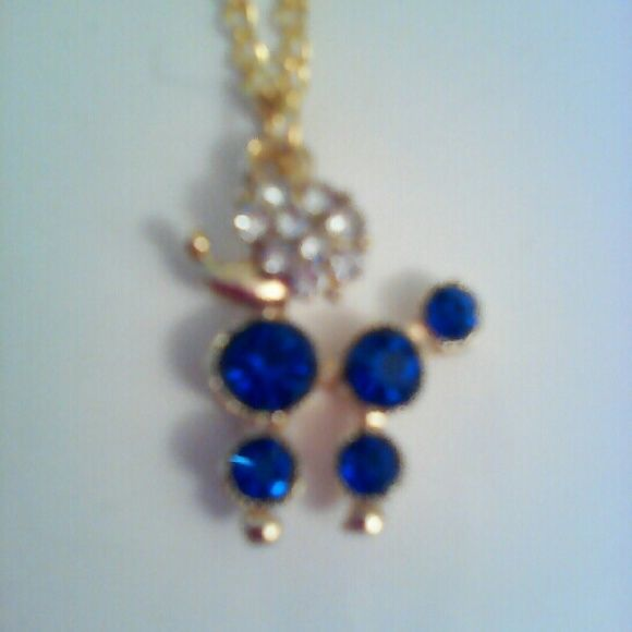 New gold blue and white pendant necklace. New gold necklace with blue and white rhinestone crystal poodle outlined in gold. A nice addition to your jewelry wardrobe. Ask for quantity available. Jewelry Necklaces