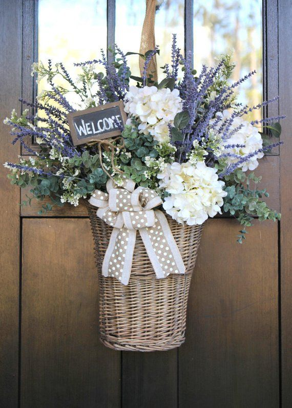 Give Your Front Door A New Twist Add A Basket Filled With Flowers